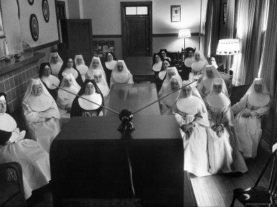 https://imgc.artprintimages.com/img/print/sisters-at-st-vincent-s-hospital-in-recreation-room-watching-program-from-new-local-tv-station_u-l-p47q300.jpg?p=0