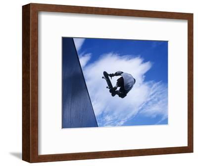 Skateboarder in Action over the Vert