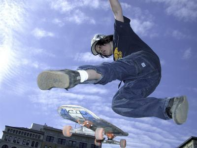 Skateboarder in Midair Doing a Trick--Photographic Print