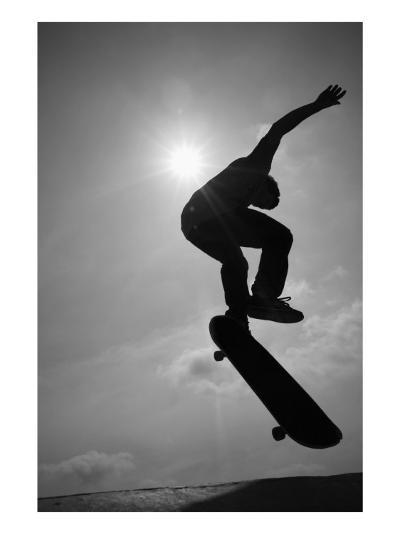 Skateboarder in the Air--Photo