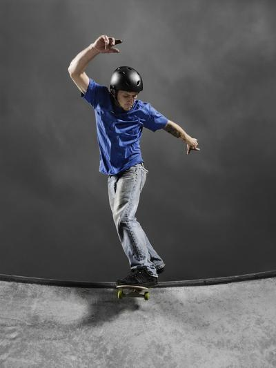 Skateboarder Performing Tricks--Photographic Print