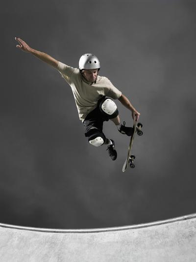 Skateboarder Performing Tricks--Photographic Print