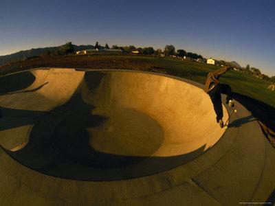 Skateboarding in a Skate Park-Bill Hatcher-Photographic Print
