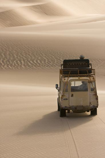 Skeleton Coast, Namibia. Land Rover Venturing Out over the Sand Dunes-Janet Muir-Photographic Print