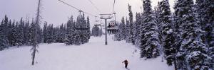Ski Lift Passing over a Snow Covered Landscape, Keystone Resort, Keystone, Colorado, USA