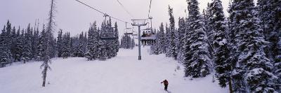 Ski Lift Passing over a Snow Covered Landscape, Keystone Resort, Keystone, Colorado, USA--Photographic Print