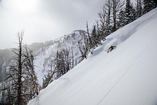 Skier Gets Backlit Powder Deep In The Teton Backcountry After A Massive Winter Storm-Jay Goodrich-Photographic Print
