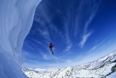 Skier Jumping from Mountain Ledge--Photo