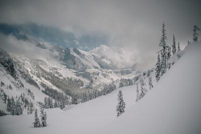 https://imgc.artprintimages.com/img/print/skier-makes-some-steep-angle-powder-turns-in-cascades-of-washington-as-a-snow-storm-begins-to-clear_u-l-q19msri0.jpg?p=0