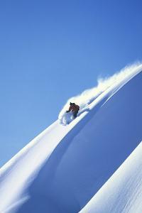 Skier Racing Down Mountain Slope