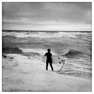 A Boy Stares at Messy Surf by Skip Brown