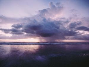 A Morning Squall Produces Rainfall over the Water by Skip Brown