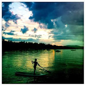 A Seven Year Old Girl Paddles a Paddle Board at Sunset on Sebago Lake by Skip Brown