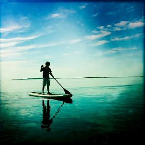 A Ten Year Old Boy on a Stand Up Paddle Board Off Orr's Island by Skip Brown