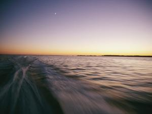 A View from a Speeding Boat as it Leaves a Wake at Twilight by Skip Brown