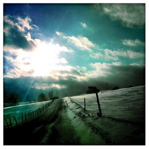 A Wind Blown Snowy Road in Western Maryland by Skip Brown