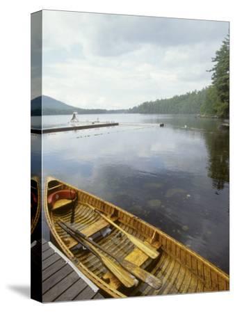 Canoe Floats Next to a Dock, Sebago Lake, Maine