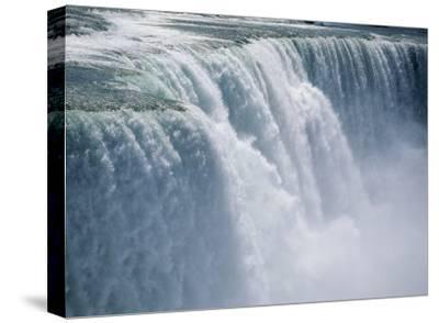 Cascade of Water Thunders Over Niagara Falls