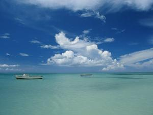 Clouds and Boats, Aruba by Skip Brown