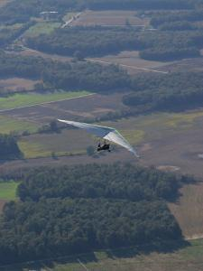 Hang-Glider Soars Over the Countryside by Skip Brown