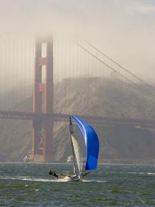 International 14 Skiff Sails under the Golden Gate Bridge, San Francisco Bay, California by Skip Brown