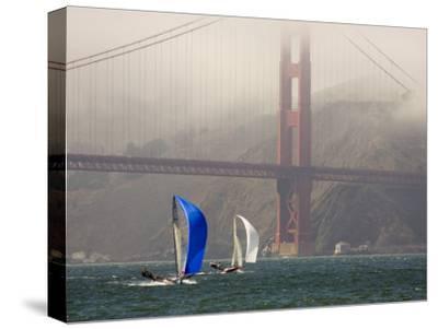 International 14 Skiffs Race under the Golden Gate Bridge, San Francisco Bay, California