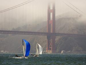 International 14 Skiffs Race under the Golden Gate Bridge, San Francisco Bay, California by Skip Brown