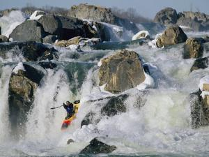 Kayaker Running Great Falls on the Potomac River in Winter by Skip Brown