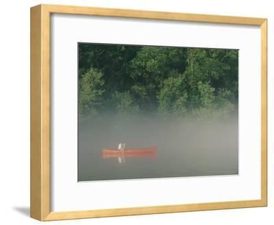 Man Paddling Canoe in Mist, Roanoke River, North Carolina