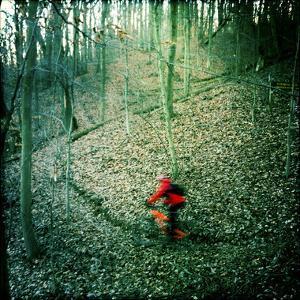 Mountain Biker on a Single Track in Winter. by Skip Brown