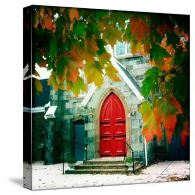 Red Church Door Framed by Autumn Leaves