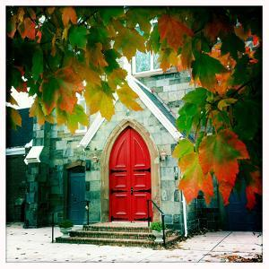 Red Church Door Framed by Autumn Leaves by Skip Brown