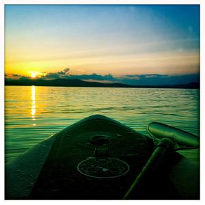 Sunset from a Standup Paddle Board on Sebago Lake, Maine by Skip Brown