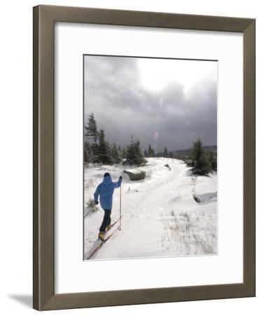Woman Cross Country Skiing Along a Ridge Trail