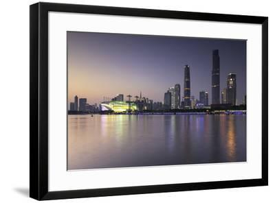 Skyline of Tianhe at dusk, Guangzhou, Guangdong, China, Asia-Ian Trower-Framed Photographic Print