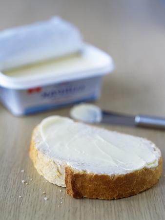 https://imgc.artprintimages.com/img/print/slice-of-buttered-bread_u-l-pzh25q0.jpg?p=0
