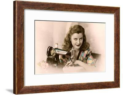 Sly Lady with Sewing Machine--Framed Art Print