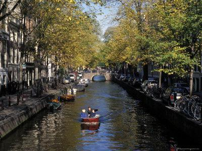 https://imgc.artprintimages.com/img/print/small-boat-on-tree-lined-oudezijds-achtenburg-wal-canal-in-the-autumn-amsterdam-the-netherlands_u-l-p1o6uf0.jpg?p=0