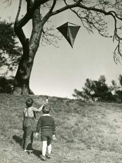 Small Boys Flying Kite-George Marks-Photographic Print