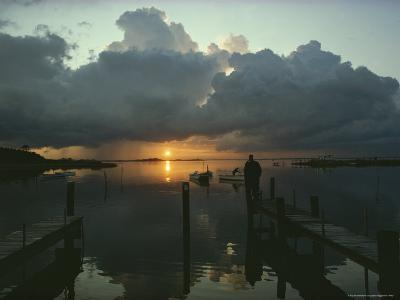 Small Fishing Boats Return to Dock as Clouds Gather at Sunset-Skip Brown-Photographic Print