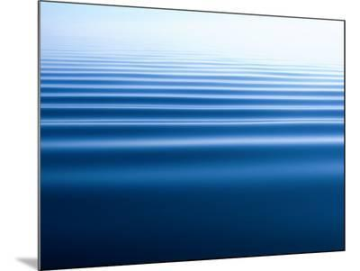 Small Gentle Ripples Move Across the Calm Surface of the Arctic Ocean-Norbert Rosing-Mounted Photo