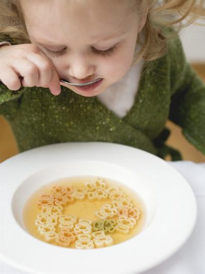 Small Girl Eating Soup with Teddy Bear Pasta--Photographic Print