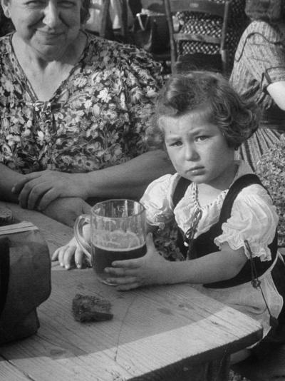 Small Girl Enjoying a Stein of Weak Beer-Dmitri Kessel-Photographic Print