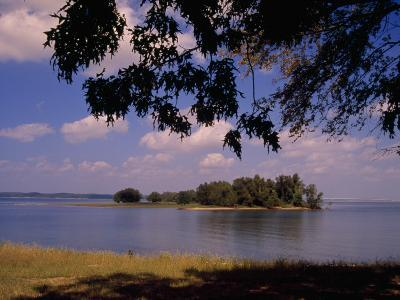 Small Island in Kentucky Lake Framed by Tree Branches-Raymond Gehman-Photographic Print