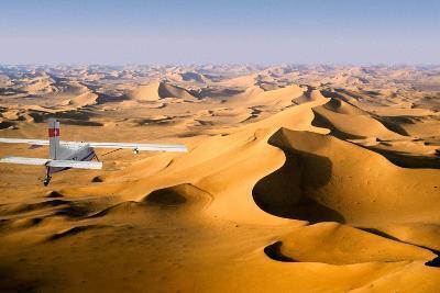 Small Plane Flying Above Giant Sand Dunes in Morning Light, Grand Erg Oriental, Algeria--Photographic Print