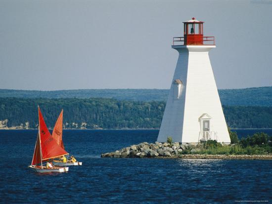Small Sailboats Racing Past a Lighthouse-Michael Melford-Photographic Print