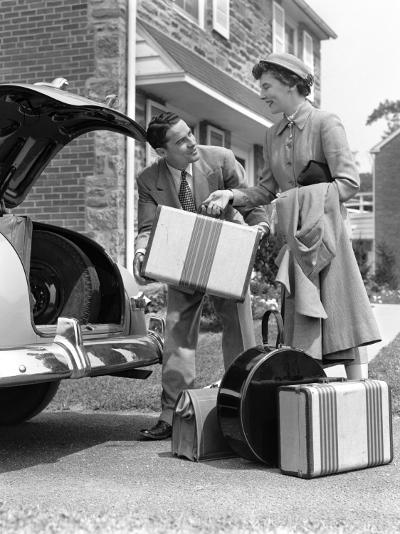 Smiling Couple Load Suitcases Into Trunk of Sedan-H^ Armstrong Roberts-Photographic Print