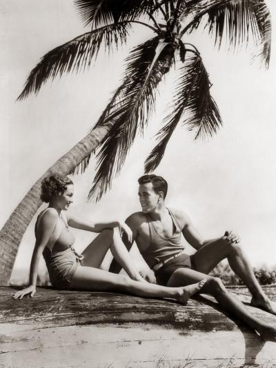 Smiling Couple Under Palm Tree Bathing-H^ Armstrong Roberts-Photographic Print