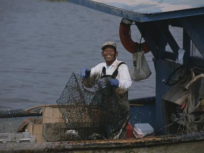 Smiling Fisherman on a Crab Boat-Medford Taylor-Photographic Print