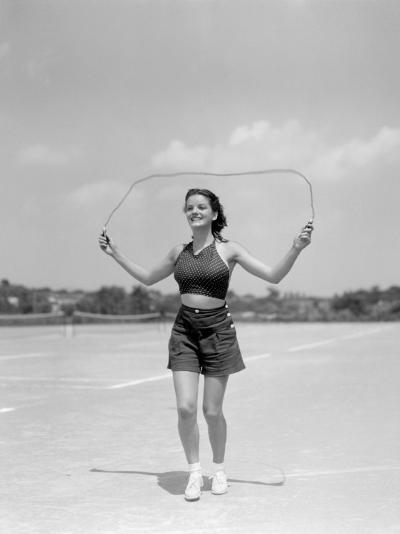 Smiling Teenage Woman Jumping Rope For Exercise Wearing Shorts and Polka Dot Halter Top-H^ Armstrong Roberts-Photographic Print